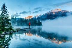 Solitary Man Enjoying Golden Sunrise Over Pyramid Mountain in Jasper, Alberta, Canada