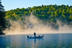 Solitary Man Fishing in the Fog royalty free stock images
