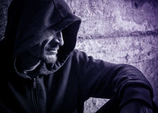 Solitary man in a hood Stock Image