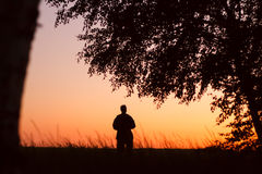 man silhouette solitary at sunset summertime Royalty Free Stock Photography