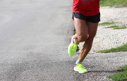 Solitary man with sportswear running in marathon Royalty Free Stock Photo