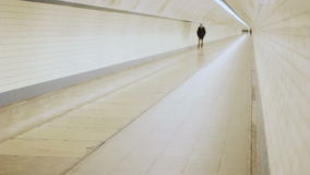 Solitary Man Walking in a Tunnel stock footage