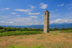 The solitary medieval stone bell tower of Saint Martin called the Ciucarun. It is the only remaining  remnant of the ancient village of Paerno demolished in the Royalty Free Stock Photos