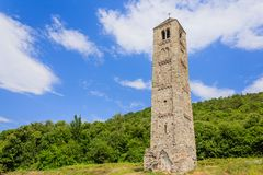 The solitary medieval stone bell tower of Saint Martin called `The Ciucarun`. It is the only remaining  remnant of the ancient village of Paerno demolished in Stock Images