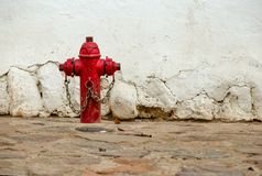 Solitary old red fire hydrant stock photos