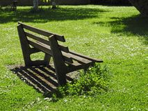 Solitary  peaceful park bench quiet peace time royalty free stock photo