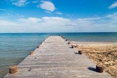 Solitary pier to the warm waters Royalty Free Stock Photo