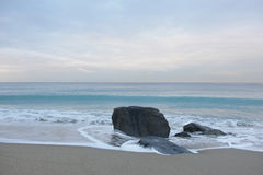 Solitary Rock Facing Peaceful Scene Royalty Free Stock Images