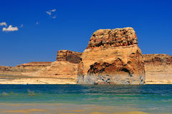 Solitary rock in the middle of Lake Powell Stock Images