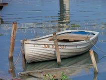 The Solitary Rowing Boat at Cojimar River. Boat tied only on pole at Cojimar river / Bote de remo atado al poste en el rio de Cojimar stock photos