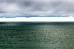 Moody aerial seascape. horizon over water, clouds. royalty free stock photography