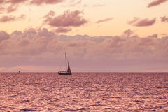A solitary sailboat in the open sea Stock Photography