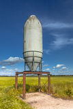 Solitary Silo in a Green Field Stock Photo