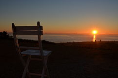 Solitary sunset Calahonda Costa del Sol Spain. Empty lone chair positioned to view the sunset from the top of Calahonda Costa del Sol Spain Royalty Free Stock Photography