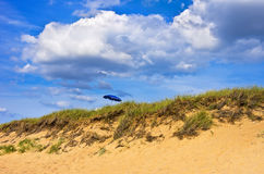 Solitary Sunshade On Lonely Beach Royalty Free Stock Photos