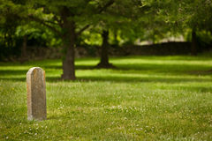 Solitary tombstome in Cemetary Stock Photo