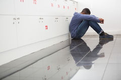 Solitary university student sitting on the floor. At the university Stock Photos