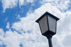 A solitary vintage street lamp in front of dramatic sky Royalty Free Stock Photography