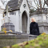 Solitary woman visiting relatives grave. Stock Photography