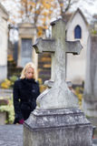 Solitary woman visiting relatives grave. Royalty Free Stock Photo