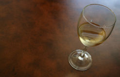 SolitaryGlassWithWhiteWine. Solitary White Wine Glass Royalty Free Stock Photography
