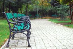 Solitude. Empty benches in an empty park in autumn Stock Photo