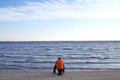 Solitude. Man at the sea coast stock image