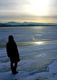 Solitude. Lonely person near water basin Liptovska Mara, Slovakia stock image