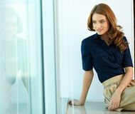Solitude. Image of calm woman in smart casual looking aside Royalty Free Stock Image
