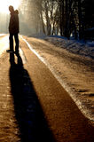 Solitude. Alone guy standing on the winter road Royalty Free Stock Image