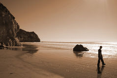 Solitude at the Beach. Young boy on a isolated beach on the California coast Stock Photo
