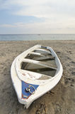 Solitude boat in the sand of a beach Stock Photos