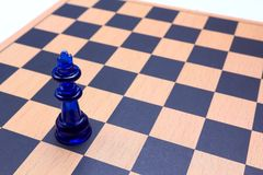Solitude. Isolated king on chess board. Illustrating solitude, loneliness Royalty Free Stock Photo
