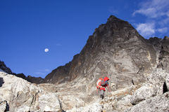 Solitude lady trekking in Himalayas region Stock Photo