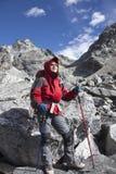 Solitude lady trekking in Himalayas region Stock Image