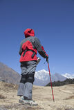 Solitude lady trekking in Himalayas region. A solitude Asian lady is trekking in Khumbu region of Himalayas, Nepal Royalty Free Stock Image