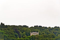 Solitude mansion standing on hill in forest. Erquy. Brittany. Stock Image