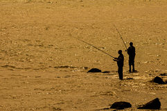 Solitude. Men fishing in the Rio Tejo in Lisbon Royalty Free Stock Photography