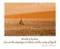 Solitude. A sailboat on Hawaiian waters. The wonderful Thomas Browne quote Be able to be alone. Lose not the advantage of solitude, and the society of thyself Royalty Free Stock Photo