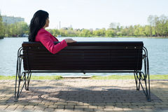 Solitude woman on bench in park Stock Photos
