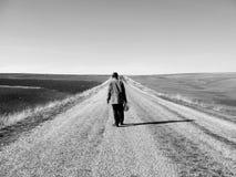 Solitudine sconosciuta della strada asfaltata e del passeggero, oscurità e passeggero Fotografia Stock