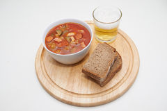 Soljanka, Russian soup with beer and bread Stock Photo