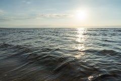Solkatt i havet arkivbilder