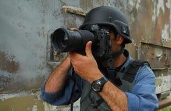 Solleciti il fotografo del giornalista fotografico fotografia stock