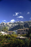 Soller City, Majorca. Building in mountains with lush vegetation, brilliant blue sky, white fluffy clouds, Soller City, Majorca Royalty Free Stock Photo