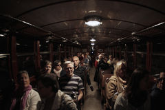 Soller train full of passengers passing through a tunnel. Soller, Spain - February 01, 2016. After a winter break the Soller train returns to make his way. From Royalty Free Stock Photos