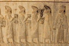 Sollievo simbolico su una parete della città antica di Persepolis Fotografia Stock Libera da Diritti