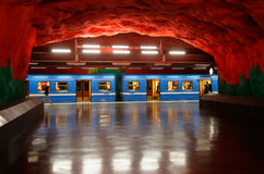 Solna centrum metro station. Solna, Sweden - June 6, 2016: One blue subway train in service for the Stockholm metro system has stoped and has open doors at the royalty free stock photography