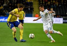 Russia national team striker Dmitry Poloz and Sweden national team player Victor Lindelof. Solna, Sweden - November 20, 2018. Russia national team striker Dmitry royalty free stock image