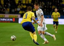 Ussia national team striker Dmitry Poloz and Sweden national team player Victor Lindelof. Solna, Sweden - November 20, 2018. Russia national team striker Dmitry royalty free stock photo
